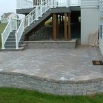 EP Henry patio and walkway installations to help you expand your outdoor living space.  Coventry I seat wall and patio.