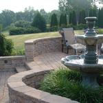 EP Henry patio and walkway installations to help you expand your outdoor living space.  Fountain creates a tranquil setting for this outdoor space.