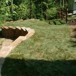 Retaining wall provided this home with additional lawn area, while preventing erosion.
