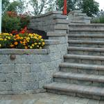 Retaining wall, with steps and low-voltage lighting.