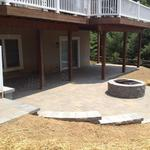 Cambridge paver patio in Avondale with retaining wall and steps helps extend outdoor living space.